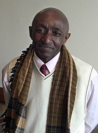 photo of a man wearing early autumn weather attire and a scarf